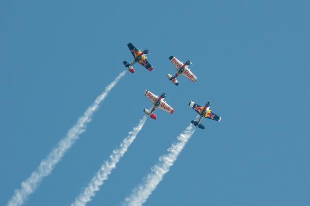 Aerobatics aircraft contrail.