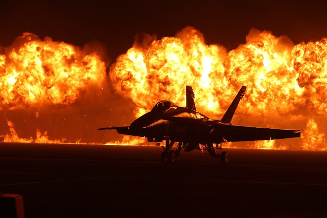 Air show flames pyrotechnics airplane.