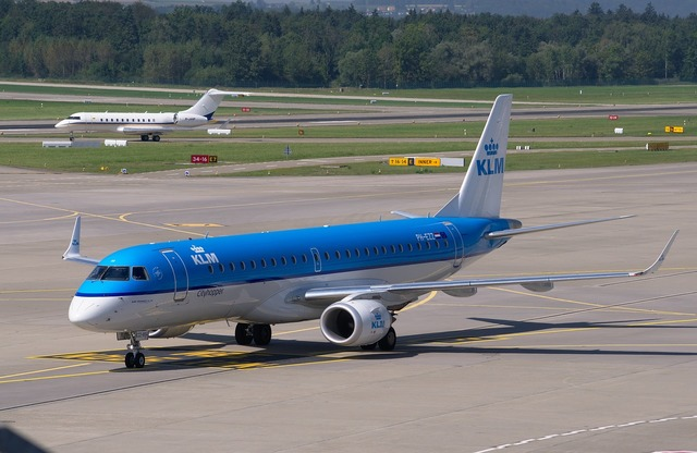 Aircraft embraer 190 klm, transportation traffic.