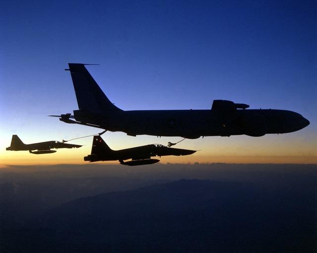 Aircraft refuel fighter jet.