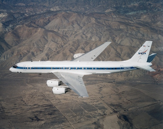 Airplane flying dc 8, science technology.