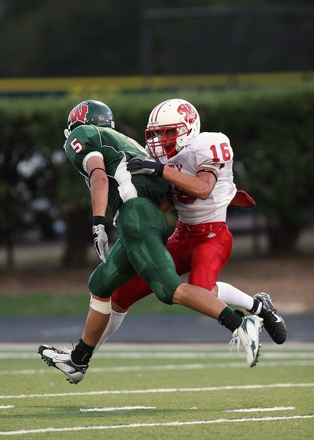 American football tackle competition, sports.