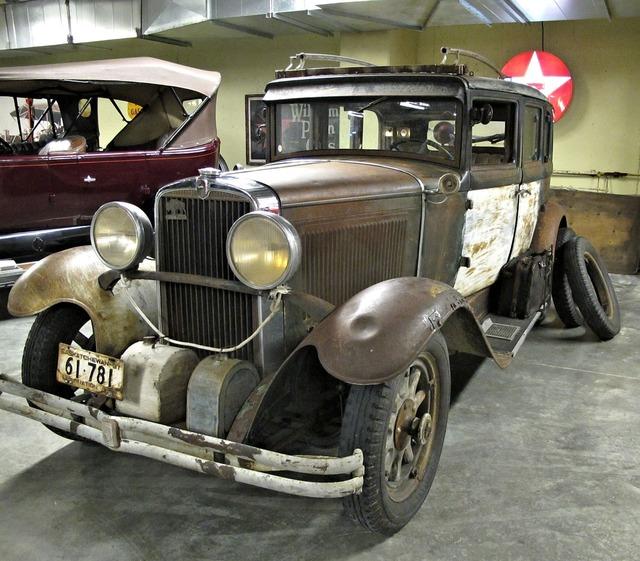 Antique car unrestored museum.