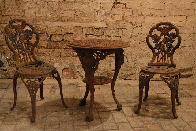 Antique cast iron pans table and chairs.