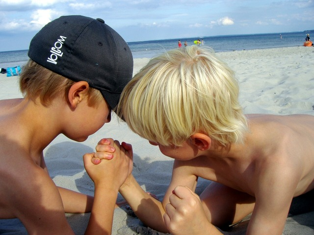 Arm wrestling beach strong, travel vacation.