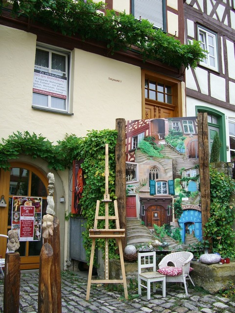 Art gallery easel art objects, nature landscapes.