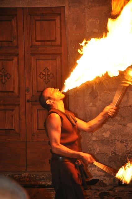 Artist fire juggler.