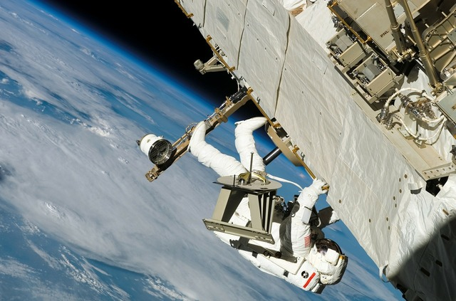 Astronaut space walk wear protective clothing, science technology.