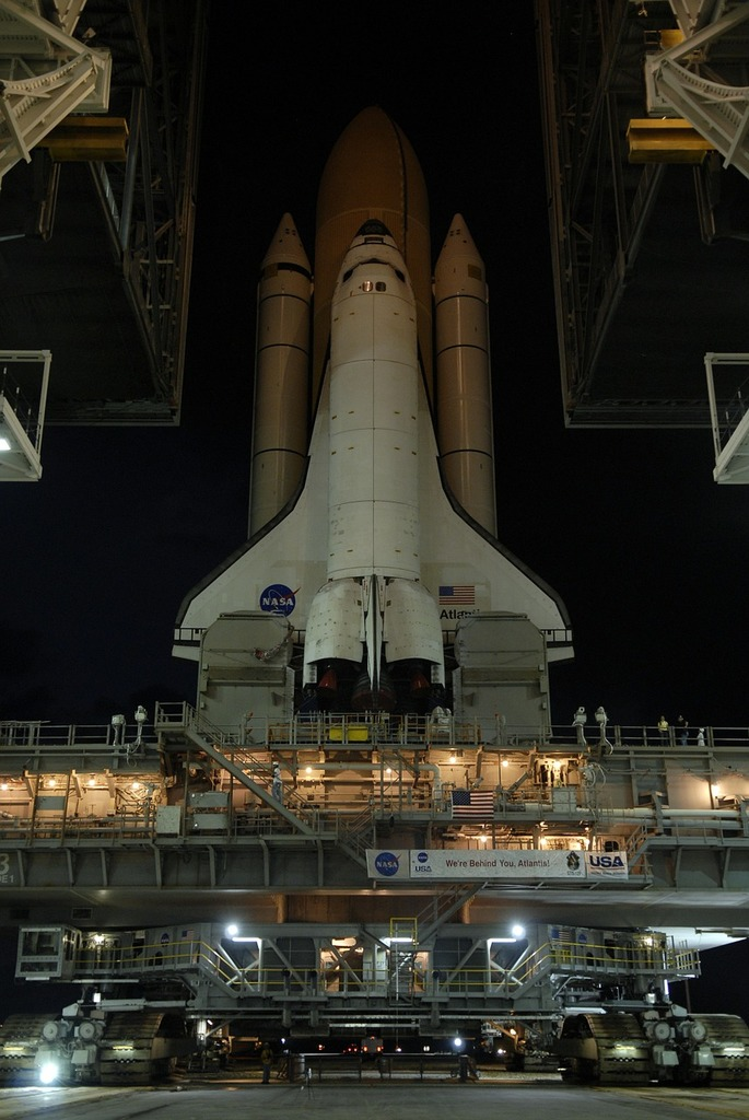 Atlantis space shuttle rollout launch, transportation traffic.
