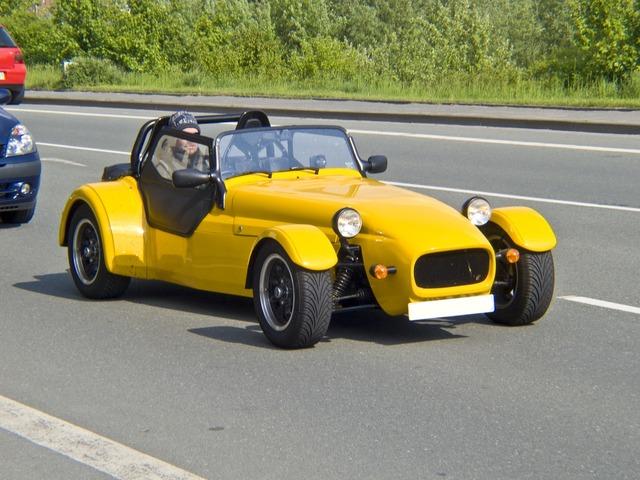 Auto racing car replica, transportation traffic.