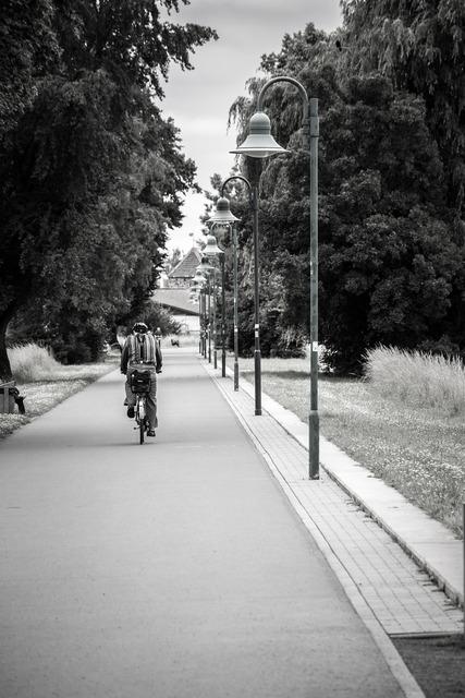 Avenue lanterns cyclists, transportation traffic.