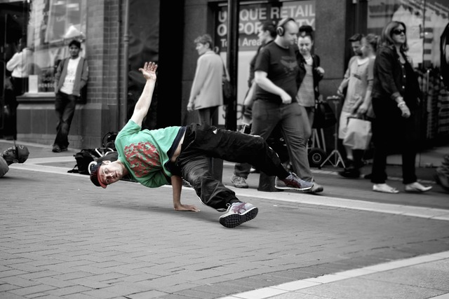 B-boying breaking breakdancing, sports.
