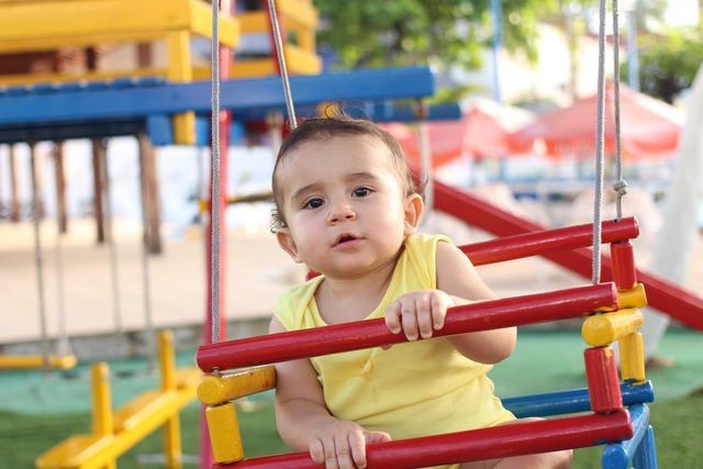 Baby playing park.