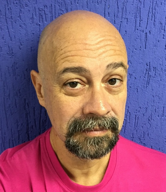 Bald middle aged goatee, people.