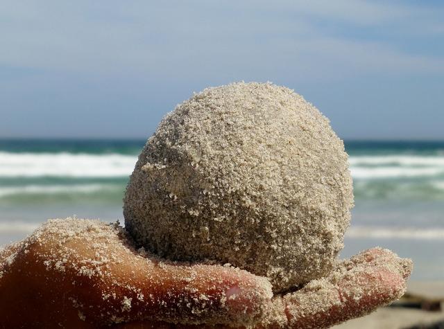 Ball sand hand, people.