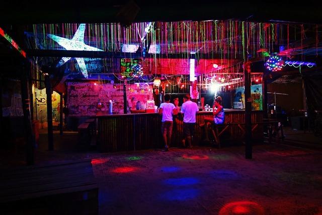 Bar night illuminated, food drink.