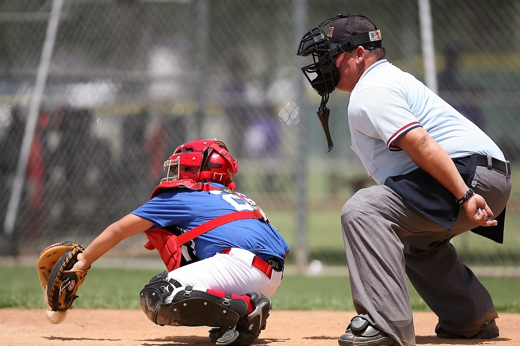 Baseball catcher umpire, sports.