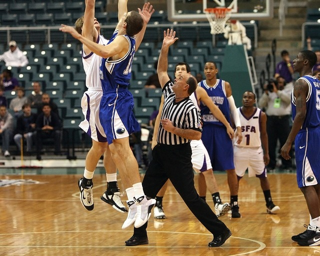 Basketball jump ball referee, sports.