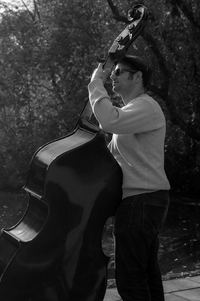 Bass player musical instrument black and white, people.