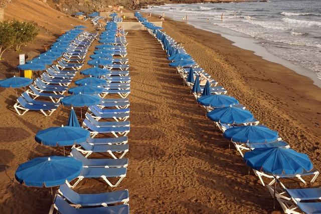 Beach concerns sun loungers, travel vacation.