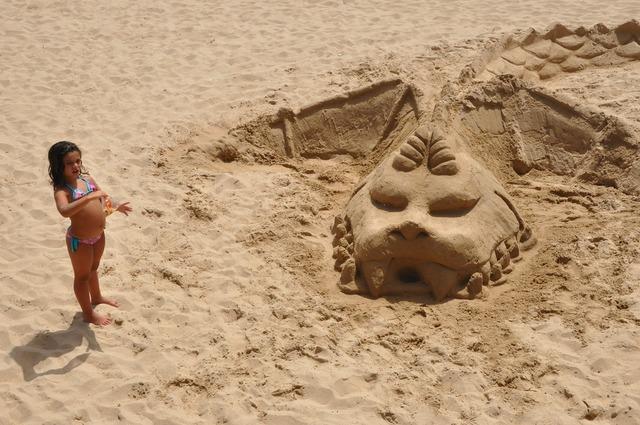 Beach construction of sand dragon, travel vacation.