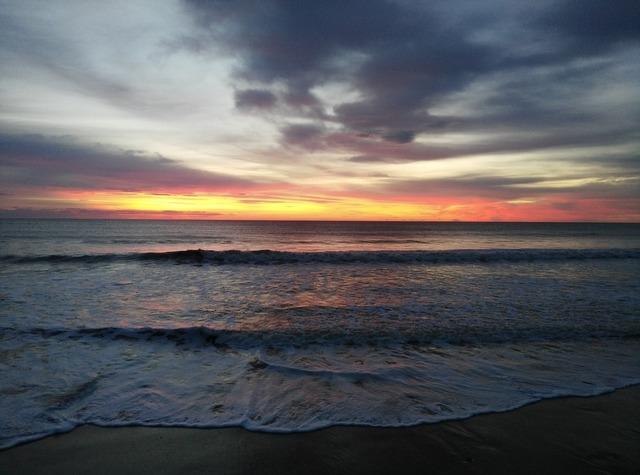 Beach dusk sunset, travel vacation.