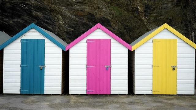 Beach hut colourful beach, travel vacation.