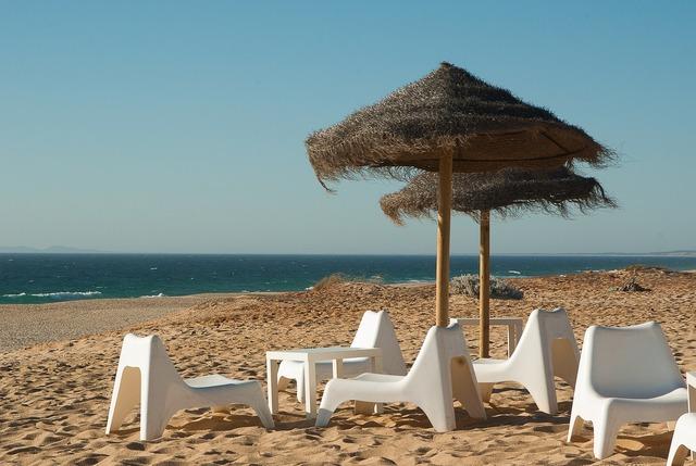 Beach parasols beach chairs, travel vacation.