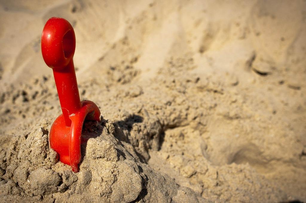 Beach sand sunlight, travel vacation.