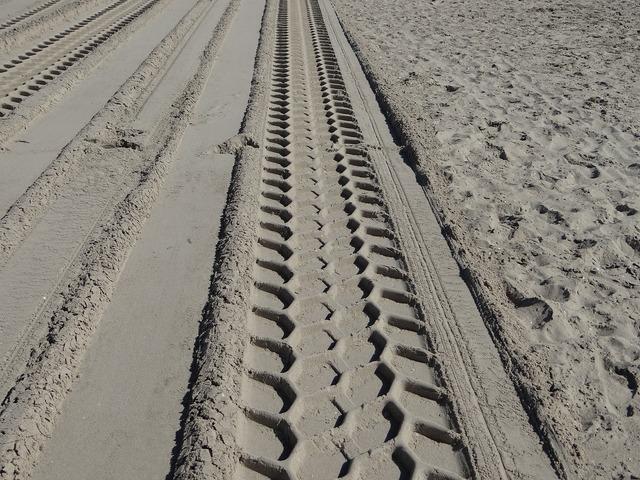Beach sand trace, travel vacation.