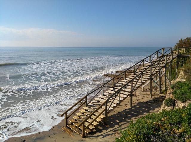 Beach sea high tide, travel vacation.