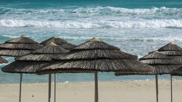 Beach umbrellas sand, travel vacation.