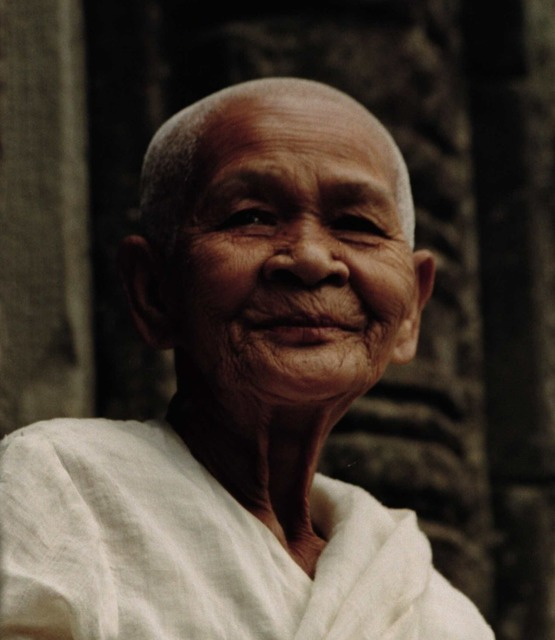 Beautiful elderly woman buddhist nun smile, emotions.
