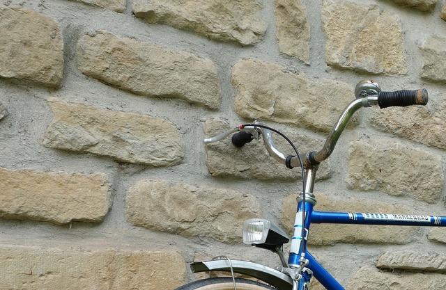 Bike wall stone wall.