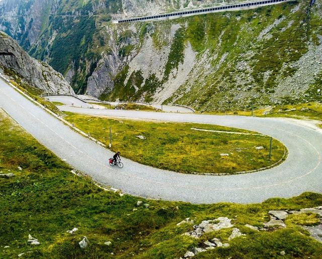 Biker ride hill, nature landscapes.