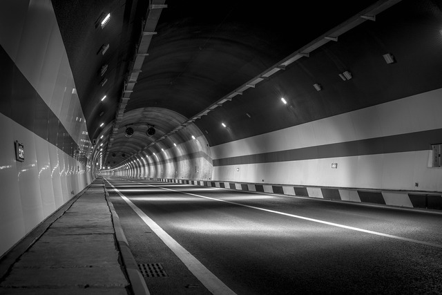 Black and white tunnel road, transportation traffic.