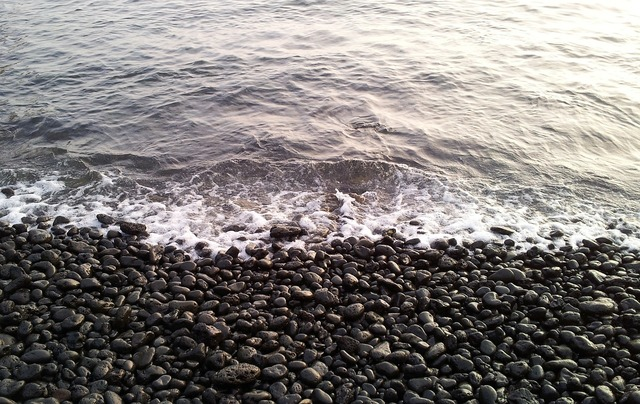 Black beach pebble, travel vacation.