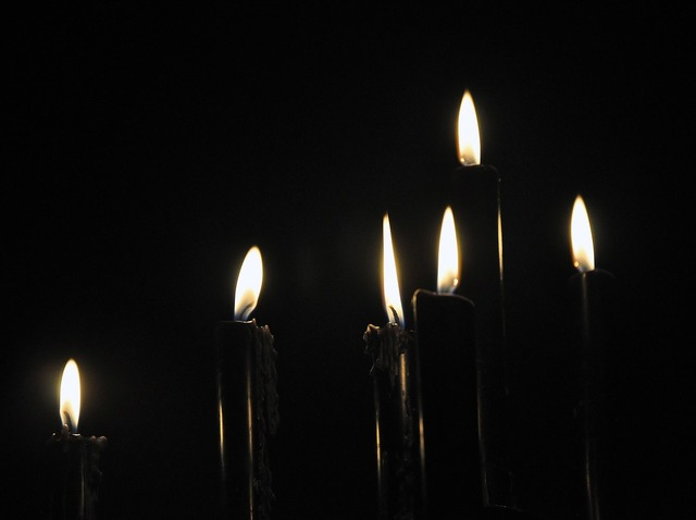 Black candles dark light.