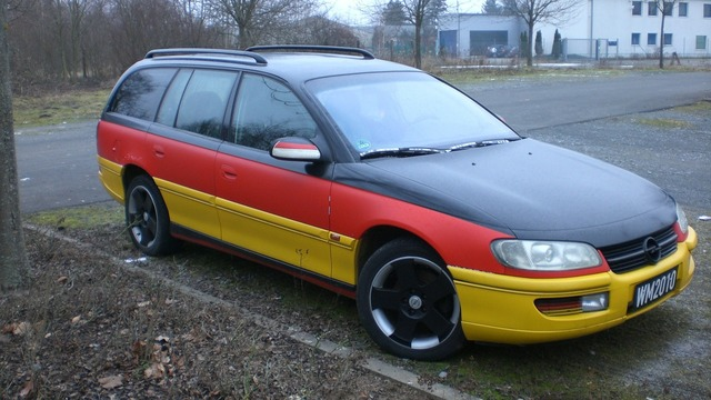 Black red gold opel omega.