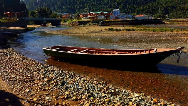 Boat stones river.