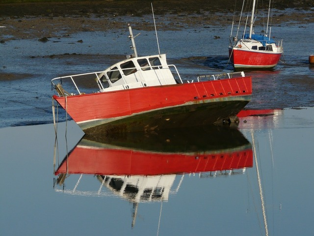 Boats beached reflection.