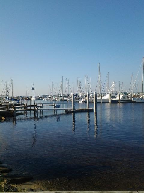 Boats marina sails, transportation traffic.