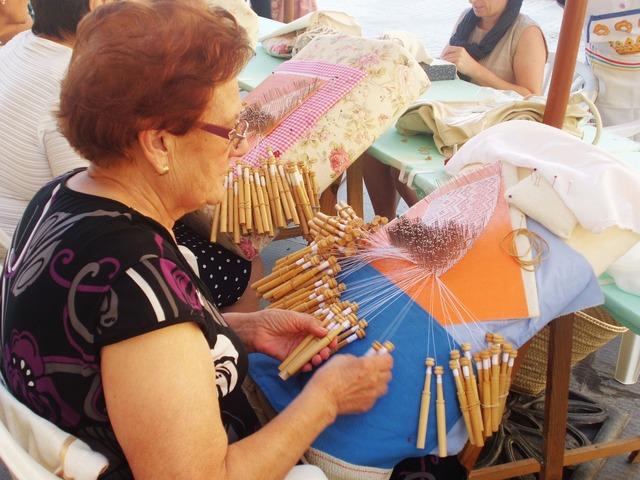 Bobbin lace weaving looms.