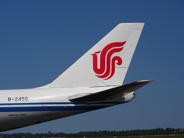 Boeing 747 air china cargo fin, transportation traffic.