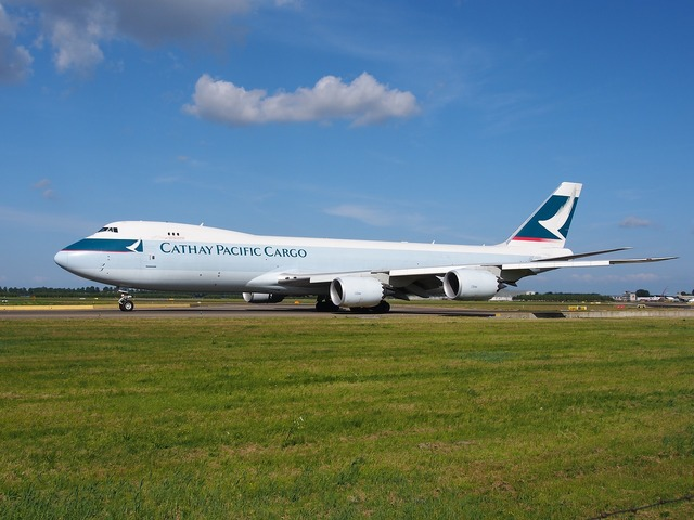 Boeing 747 cathay pacific jumbo jet, transportation traffic.