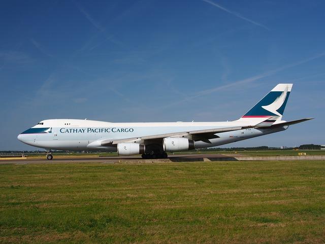 Boeing 747 cathay pacific jumbo jet, transportation traffic.
