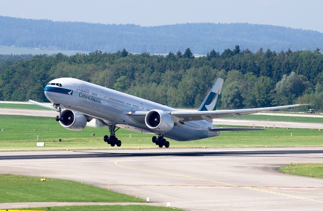 Boeing 777 cathay pacific airport zurich, transportation traffic.