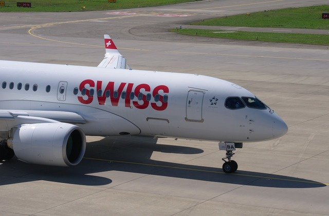 Bombardier cs100 swiss airlines aircraft, transportation traffic.