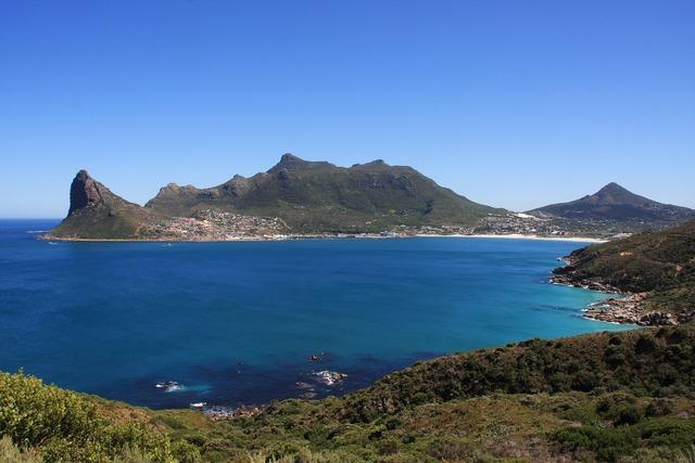 Booked beach kamps bay, travel vacation.