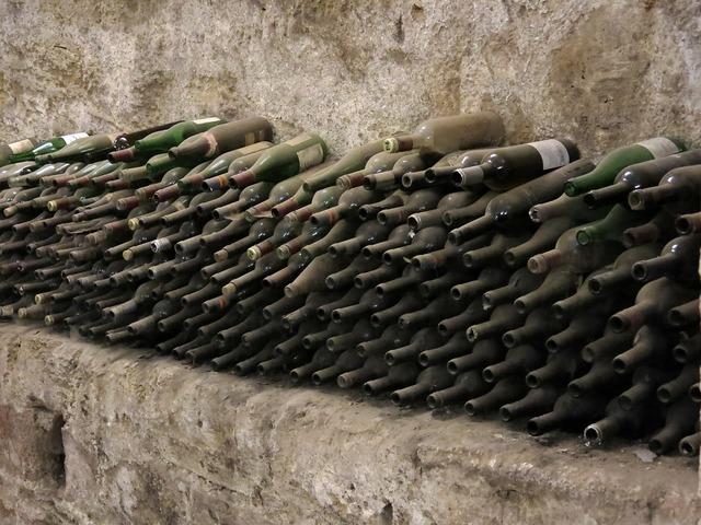 Bottles wine dusty.
